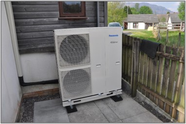 A heat pump outside a home managed by the West Highland Housing Association